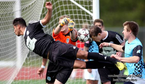 The Hammers and Victory battle for the ball Sunday in Bellingham. (David Willoughby)