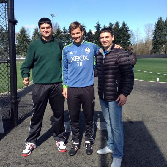 Cesar, far left, meets Sounders FC goalkeeper coach Tom Dutra. Javier Reyna is at right.