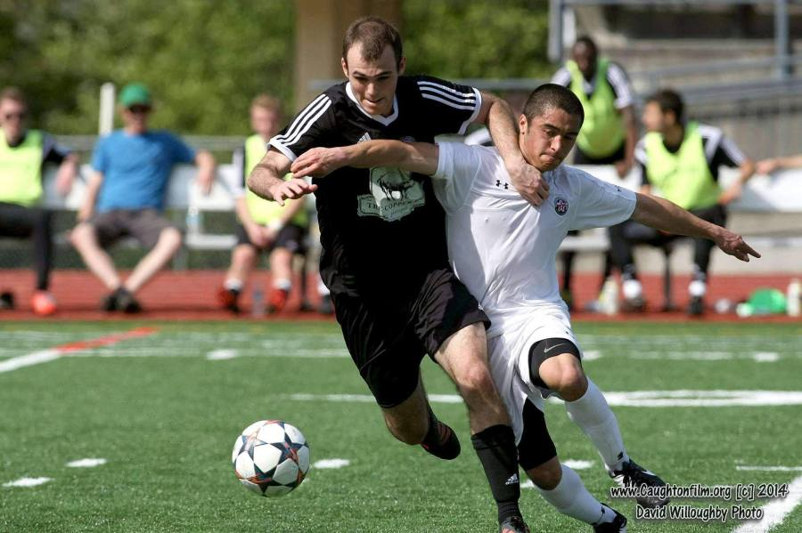 Bellingham United (black) takes on WestSound FC early in the EPLWA campaign. The league is now has national recognition as a Premier League. (David Willoughby)