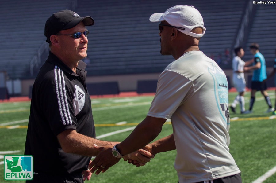 Bellingham head coach Lance Calloway (left) and Vancouver head coach Biniam Afenegus shake shake hands after the match. (Bradley York)