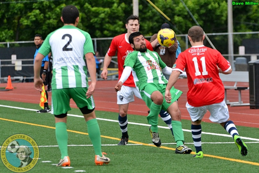 South Sound (red) and Wenatchee (green / white) battle for the ball last Saturday in Lakewood for the South Sound home opener. (Dave Miller)