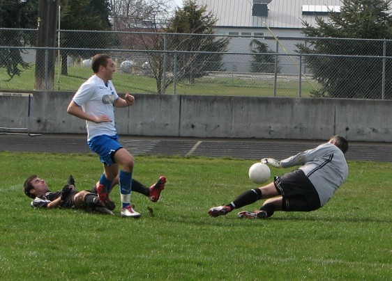 In 2011 Graham Davidson takes a shot on goal during Kitsap Pumas pre-season. On Sunday in Bellingham he scored the first goal in WestSound FC's EPLWA history ---and it was a match-winner. (David Falk)