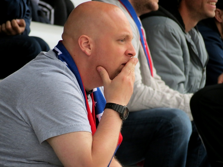 A scarf-wearing South Sound supporter watches intently in the club's Lakewood debut. (David Falk)