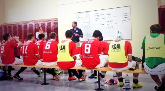 Head coach Adam Becker talks with the Shock at halftime against Vancouver.