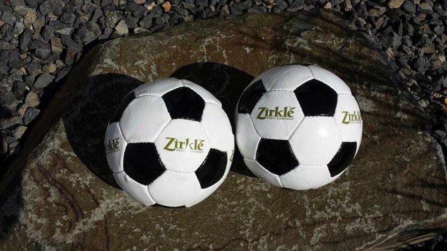 Zirkle Furit Company gave hundreds of balls away to kids after the match.