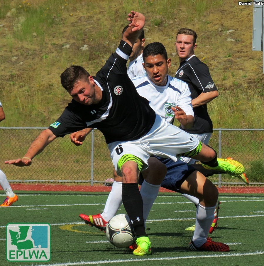 Leo Potts takes a spill. Later he scored both goals as WestSound FC won against Seattle. (David Falk)