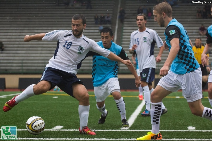 Seattle (white) and vancouver (blue) played another thriller on Saturday. V2FC remains in second after a 3-2 stoppage-time win. (Bradley York)