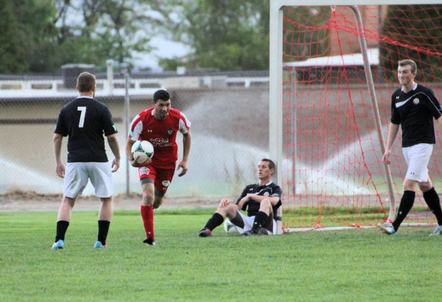 Hector Valdovinos gets the ball back after scoring against WestSound FC. (Tracie Fowler.)