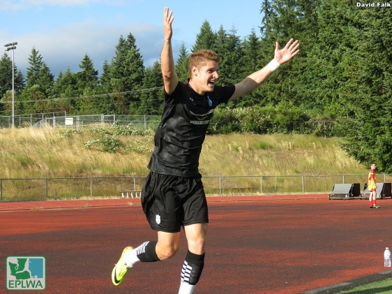 Jordan Jones raises his arms in joy after completing a first-half hat trick over a 13-minute spell. (David Falk)