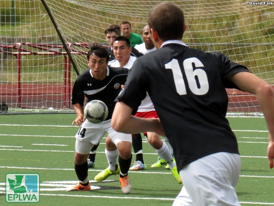 Izzy Deluna (left) eyes the incoming ball. He scored a brace to help the WestSound cause. (David Falk)