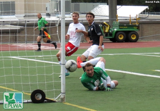 Jacob Rhoades watches as his save hits the post in the second half. Yakima cleared the ball as it bounced back into the box. (David Falk)