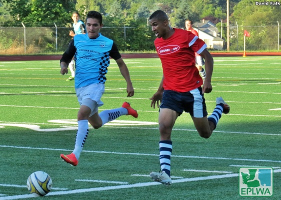 Mike Ramos races a Vancouver defender down the sideline at McKenzie Stadium. (David Falk)