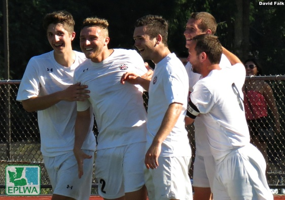 All smiles for WestSound after Graham Davidson (second from left) scored a free kick zinger to put the home team up 3-2 in the 70th minute. (David Falk)