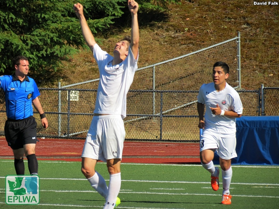 Colin Ralston raises his arms after completing his hat trick, the first in club history. (David Falk)