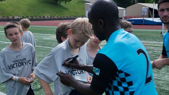 Alex Nimo signs autographs after Sunday's V2FC home opener. (Nathan Goddard)