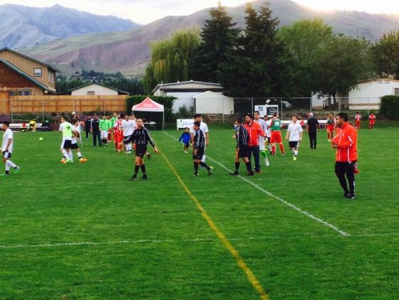 Post-match: Players mingle after Wenatchee's 1-0 win. (Hoppers Twitter)
