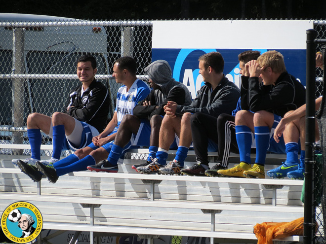 Kitsap Pumas players watch the Olympic Force play in a pre-season tournament. (David Falk)